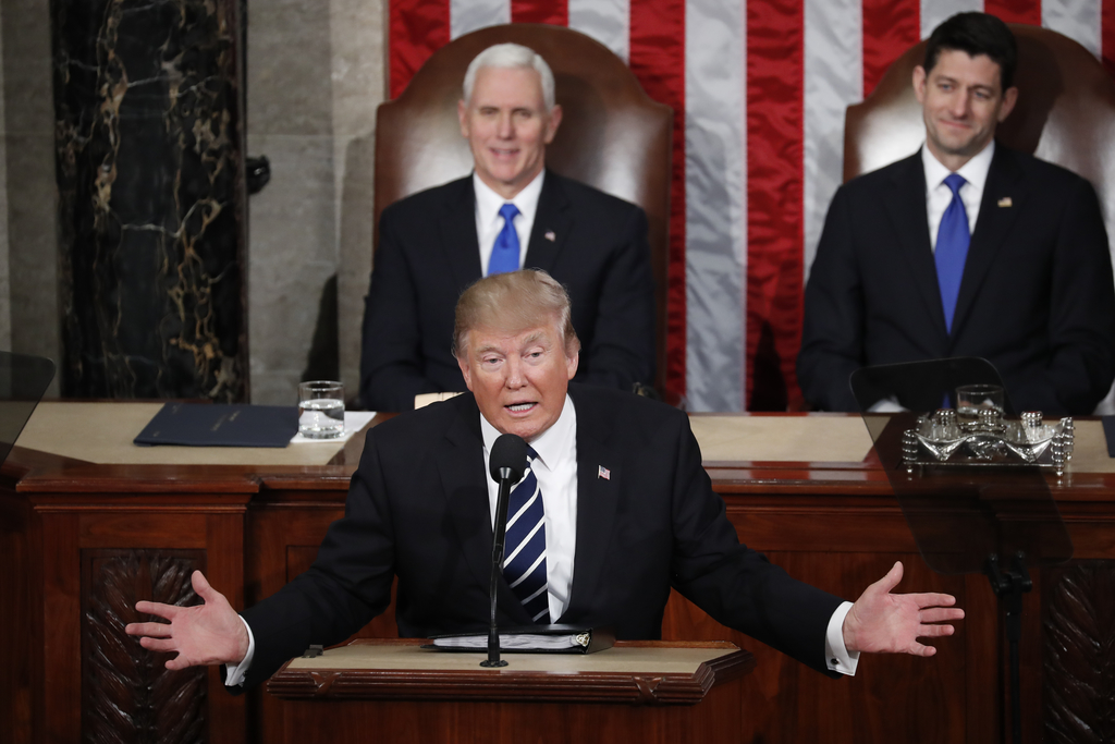 President Donald Trump addresses a joint session of Congress on Capitol Hill in Washington, Tuesday, Feb. 28, 2017, as Vice President M...