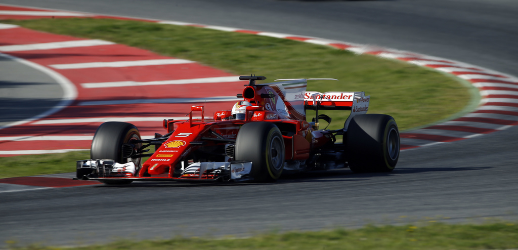 Ferrari driver Sebastian Vettel of Germany takes a curve during a Formula One pre-season testing session at the Catalunya racetrack in ...