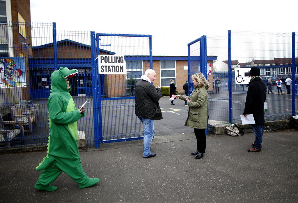 People arrive to vote at a polling station in West Belfast, Northern Ireland, Thursday, March 2, 2017. Voting has begun Thursday in the...