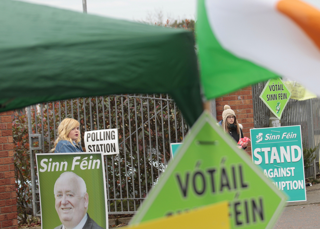 Voters leave a polling station in West Belfast, Northern Ireland, Thursday, March 2, 2017. Voting has begun Thursday in the British pro...