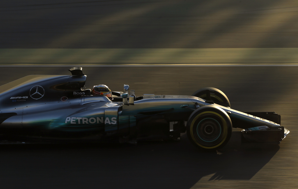 Mercedes driver Lewis Hamilton of Britain steers his car during a Formula One pre-season testing session at the Catalunya racetrack in ...
