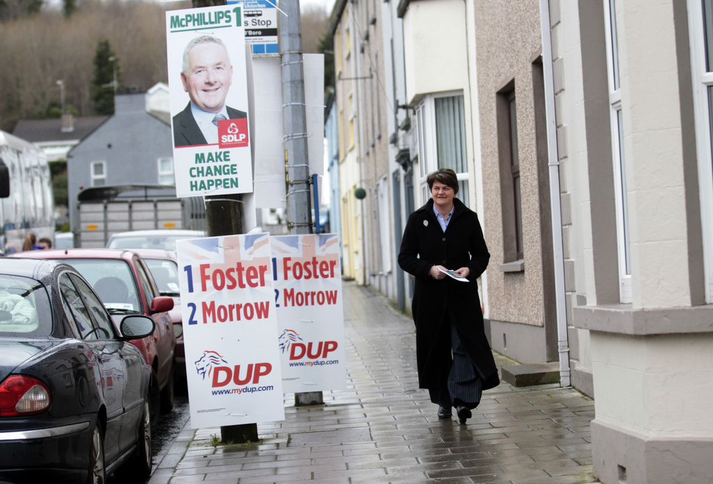 Democratic Unionist Party leader Arlene Foster arrives to cast her vote at a polling station in Brookeborough, Northern Ireland, Thursd...