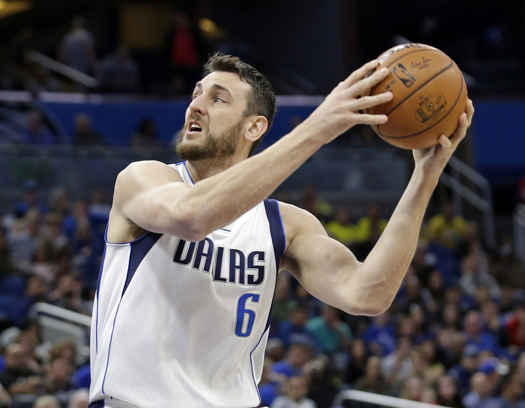FILE - In this Nov. 19, 2016, file photo, Dallas Mavericks' Andrew Bogut (6) looks for a shot against the Orlando Magic during the firs...