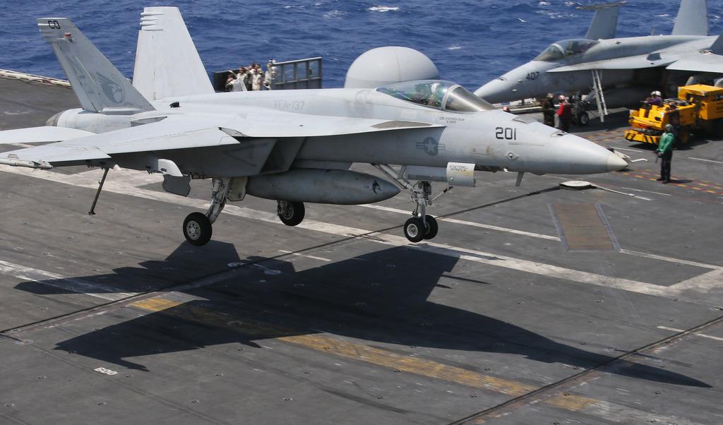 A U.S. Navy F18 fighter jet lands on the U.S. Navy aircraft carrier USS Carl Vinson (CVN 70) following a routine patrol off the dispute...