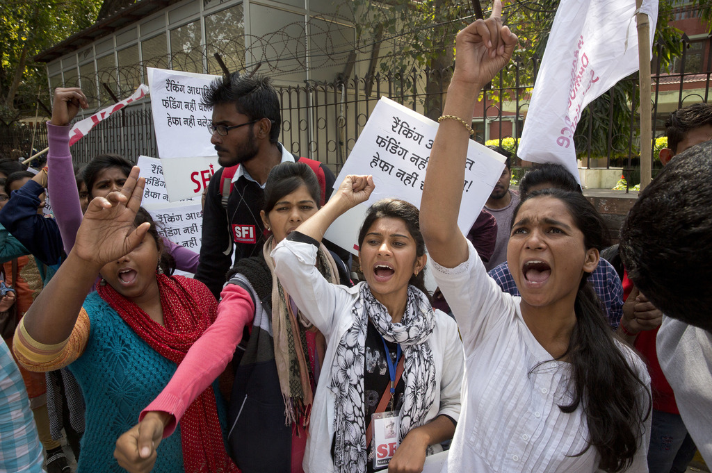 In this Friday, March 3, 2017, photo members of Student Federation of India shout anti government slogans during a protest march to the...