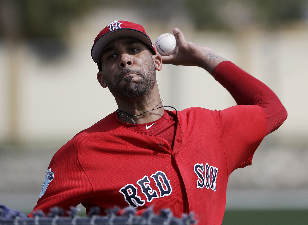 FILE - In this Feb. 19, 2017, file photo, Boston Red Sox pitcher David Price throws a live batting session at a spring training basebal...