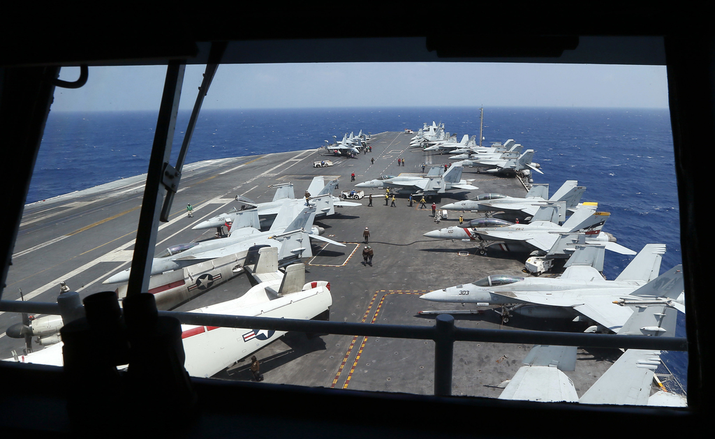 Fighter jets on board the U.S. Navy aircraft carrier USS Carl Vinson (CVN 70) are prepared for patrols off the disputed South China Sea...