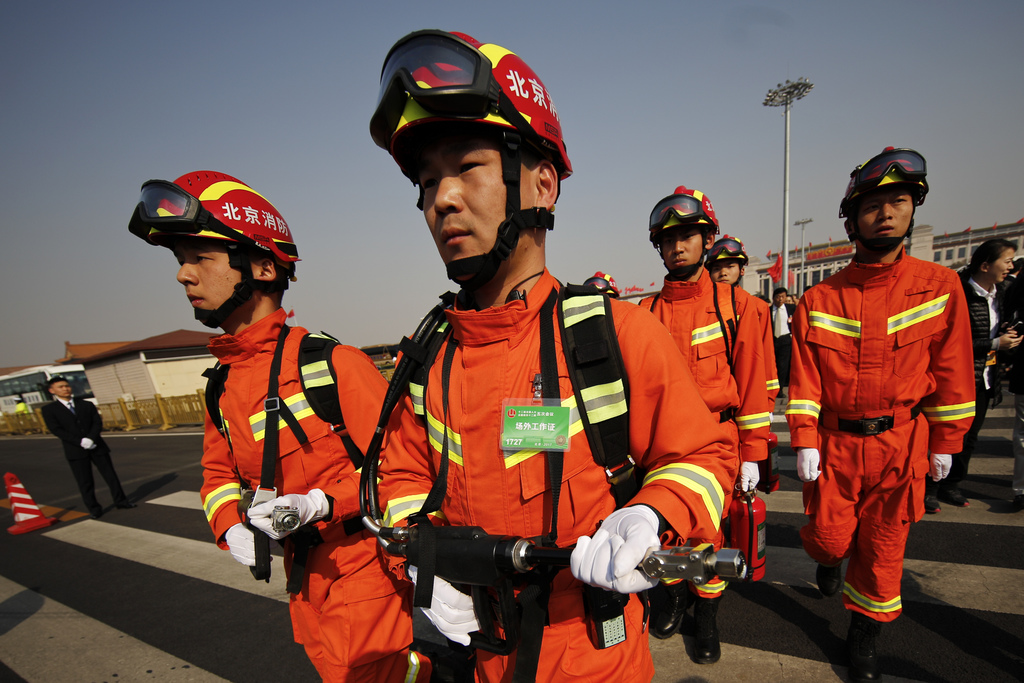 Chinese paramilitary firefighters march as delegates to the Chinese People's Political Consultative Conference (CPPCC) arrive for the o...