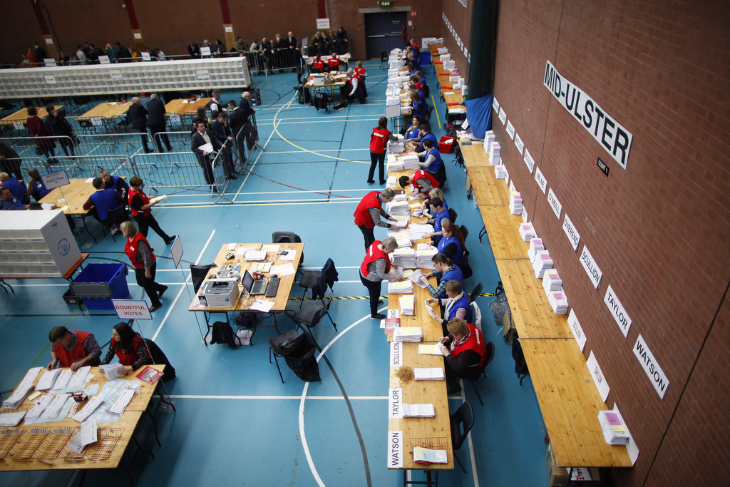 Election workers continue to tally up votes in the count centre in Ballymena, Northern Ireland, Friday, March 3, 2017. Counting has beg...