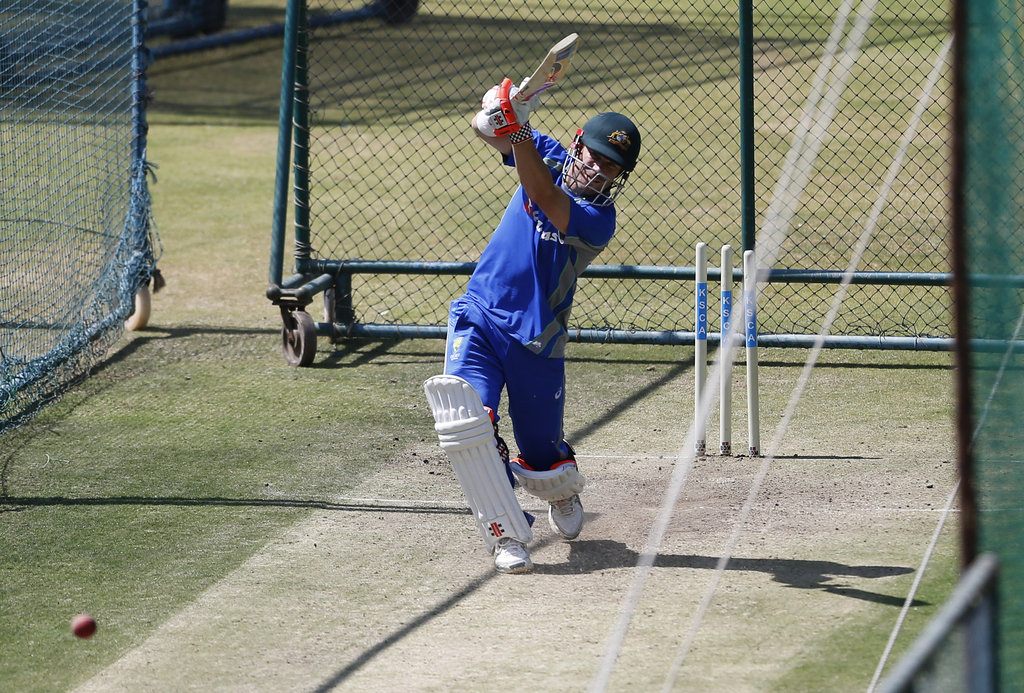 Australia's David Warner bats in the nets during a training session ahead of their second cricket test match against India in Bangalore...