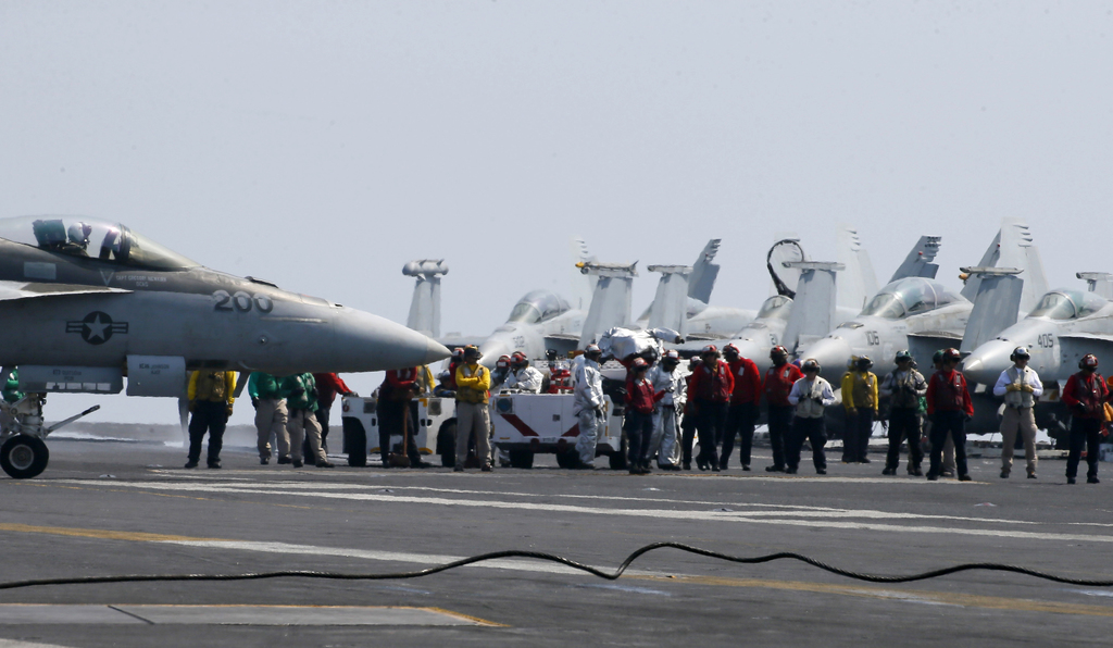 Fighter jets on board the US Navy aircraft carrier USS Carl Vinson (CVN 70) are prepared for patrols off the disputed South China Sea F...