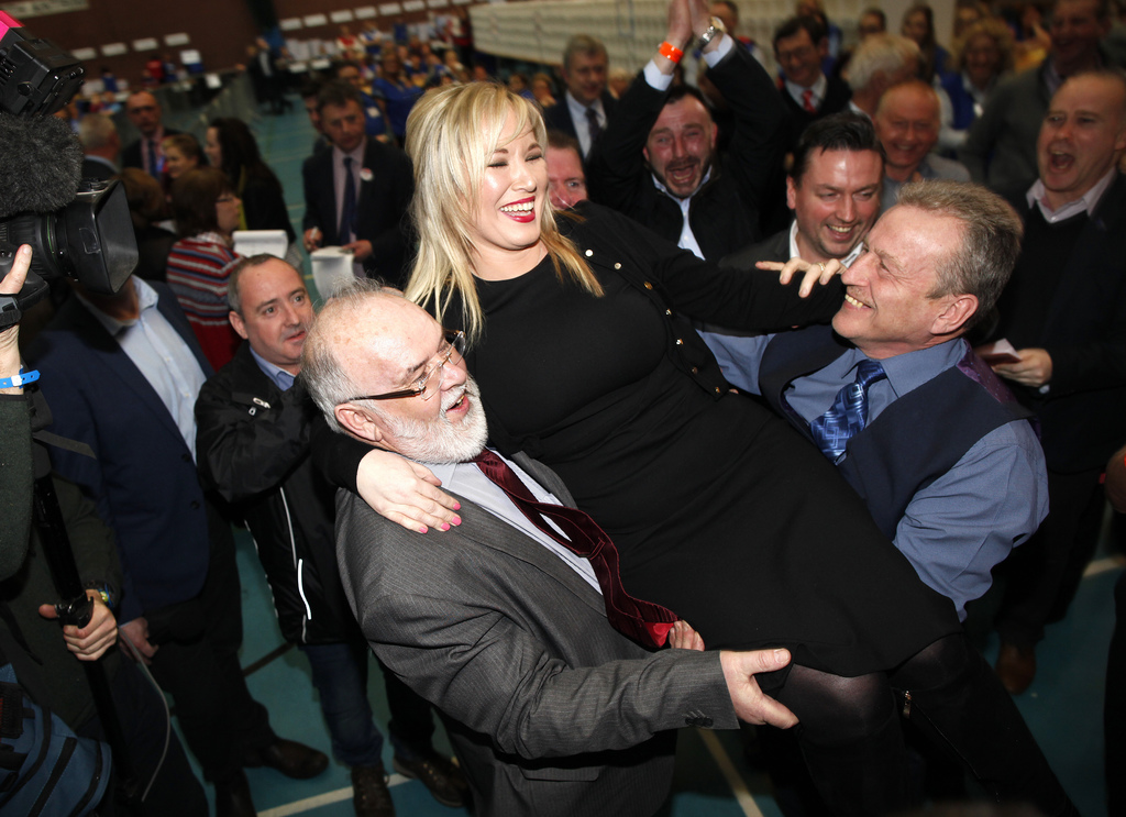 Sinn Fein's party leader for Northern Ireland Michelle O'Neill celebrates with party members Francie Molloy, left, and Ian Milne, right...