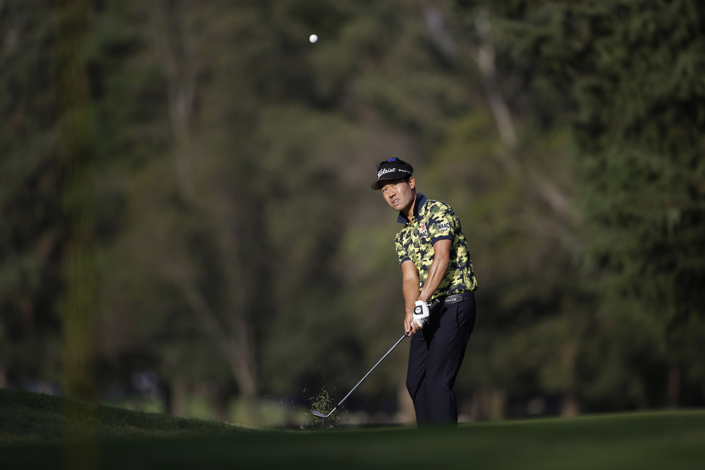 Kevin Na, of the U.S., chips the ball on the 9th hole in round one of the Mexico Championship at Chapultepec Golf Club in Mexico City, ...