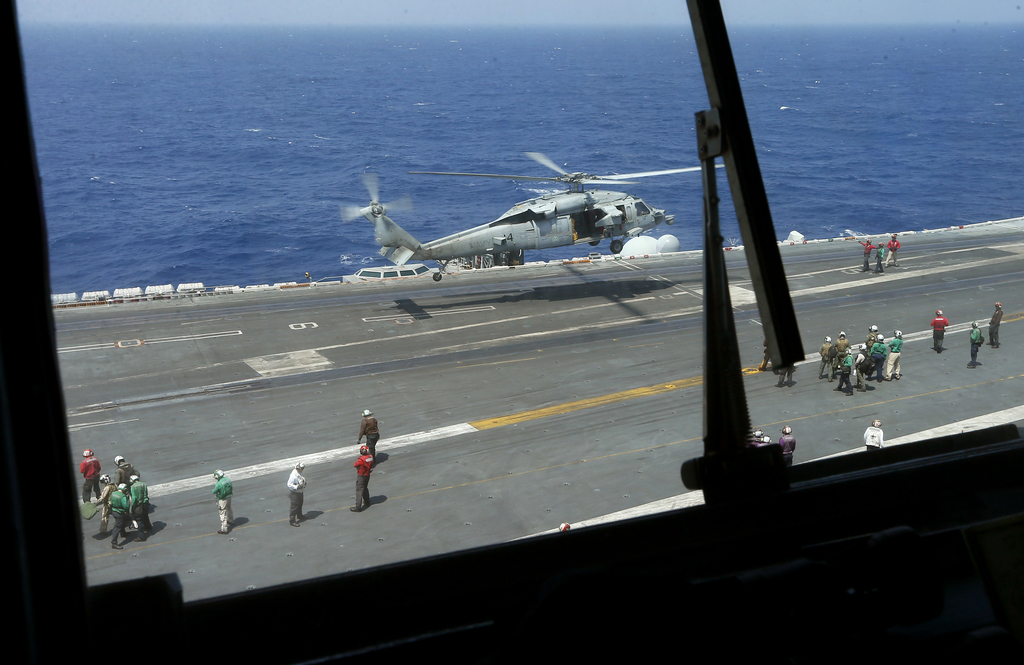 A U.S. Navy Sea Hawk helicopter from the U.S. Navy aircraft carrier USS Carl Vinson (CVN 70) takes off for a routine patrol off the dis...