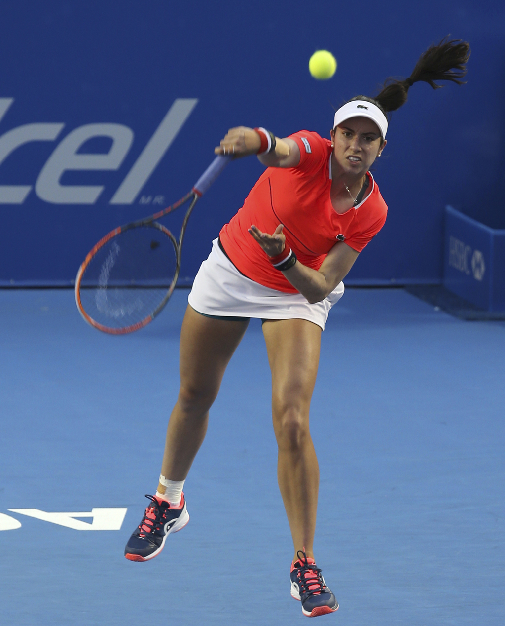 Christina Mchale, from the U.S., serves to France's Kristina Mladenovic during a semifinal match of the Mexican Tennis Open in Acapulco...