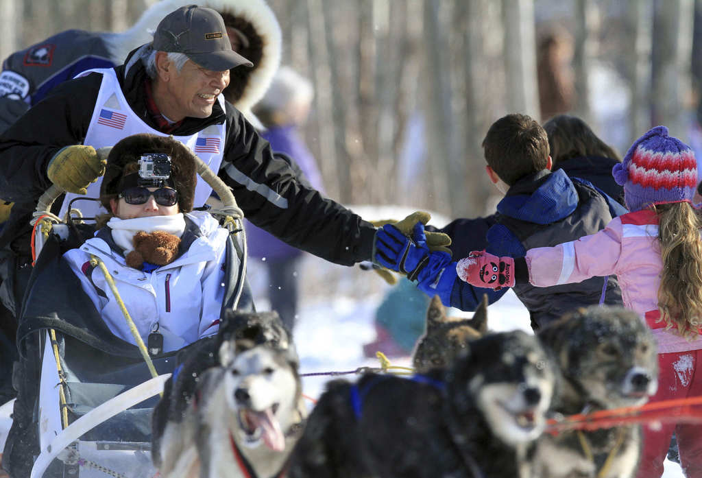 This March 2, 2013, file photo shows musher Mike Williams Sr. greeting fans during the ceremonial start of the Iditarod Trail Sled Dog ...