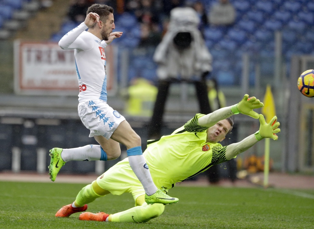 Napoli's Dries Mertens scores his side's second goal during a Serie A soccer match between Roma and Napoli, at the Rome Olympic stadium...
