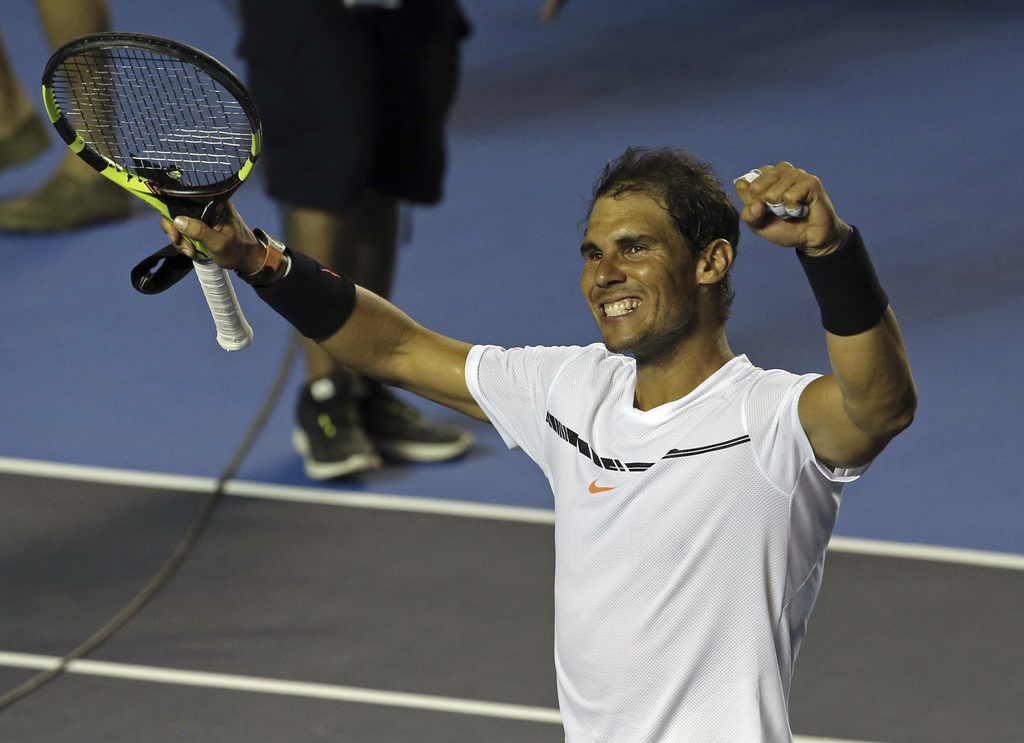 Spain's Rafael Nadal celebrates after defeating Croatia's Marini Cilic during a semifinal match of the Mexican Tennis Open in Acapulco,...