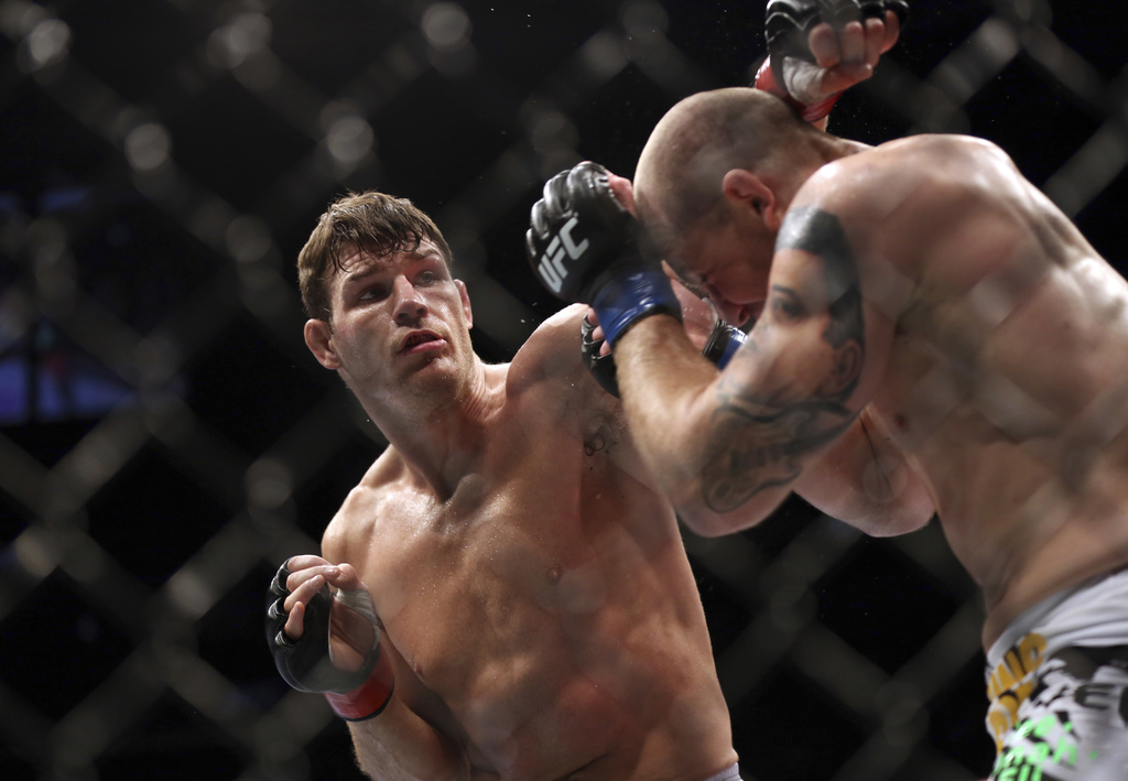 FILE - In this April 27, 2013, file photo, Michael Bisping, left, fights Alan Belcher during their UFC 159 mixed martial arts middlewei...