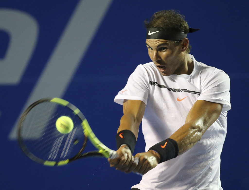 Spain's Rafael Nadal returns the ball to Croatia's Marini Cilic during a semifinal match of the Mexican Tennis Open in Acapulco, Mexico...
