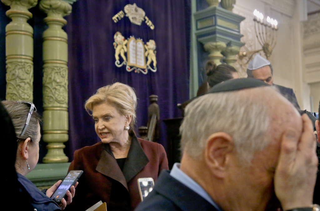 Congresswoman Carolyn Maloney, center, member of Congress's bipartisan task force combating anti-Semitism, speaks with a reporter after...