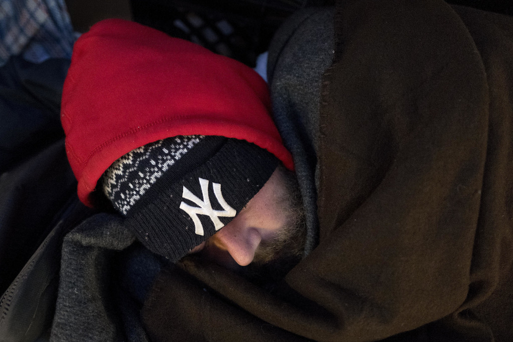 FILE - In this Jan. 5, 2017 file photo, a homeless man sleeps on a sidewalk in midtown New York. New York City's latest attempt to tack...