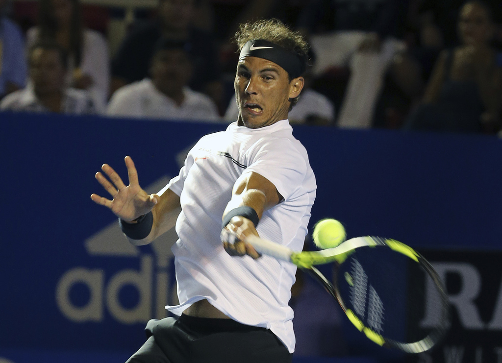 Spain's Rafael Nadal plays a return to Croatia's Marini Cilic during a semifinal match of the Mexican Tennis Open in Acapulco, Mexico, ...