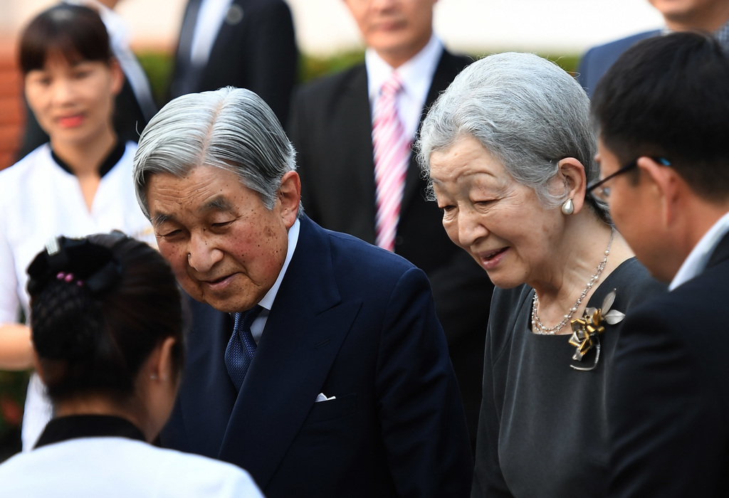 Japan's Emperor Akihito, center left, and Empress Michiko meet with Japanese volunteers from Japanese International Cooperation Agency ...