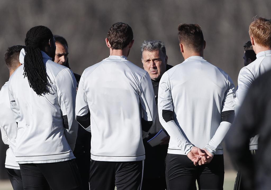 "FILE- In this Feb. 16, 2017, file photo, Atlanta United coach Gerardo ""Tata"" Martino talks with his players during a soccer training se..."