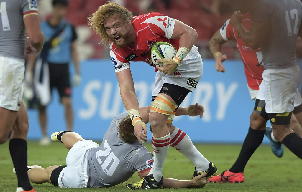 Japan's Williem Britz of the Sunwolves is tackled by South Africa's Christopher Anthony Cloete of the Southern Kings during their Super...