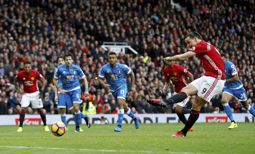 Manchester United's Zlatan Ibrahimovic takes a penalty that was saved, during their English Premier League soccer match against AFC Bou...
