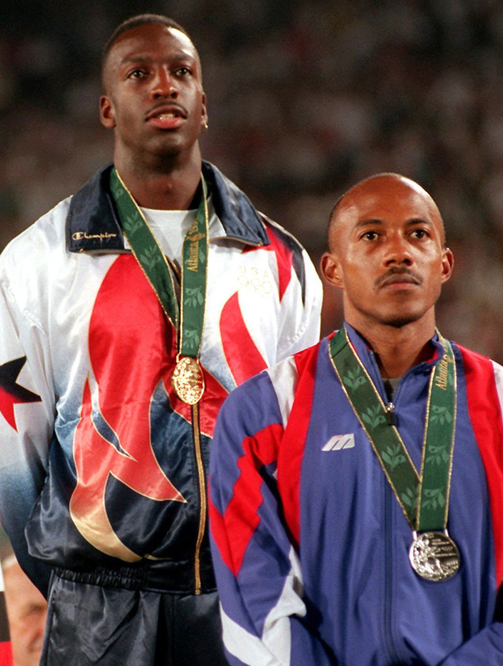 FILE - This is a Thursday Aug. 1, 1996 file photo of  Frankie Fredericks of Namibia, right, wearing his silver medal with  Michael John...
