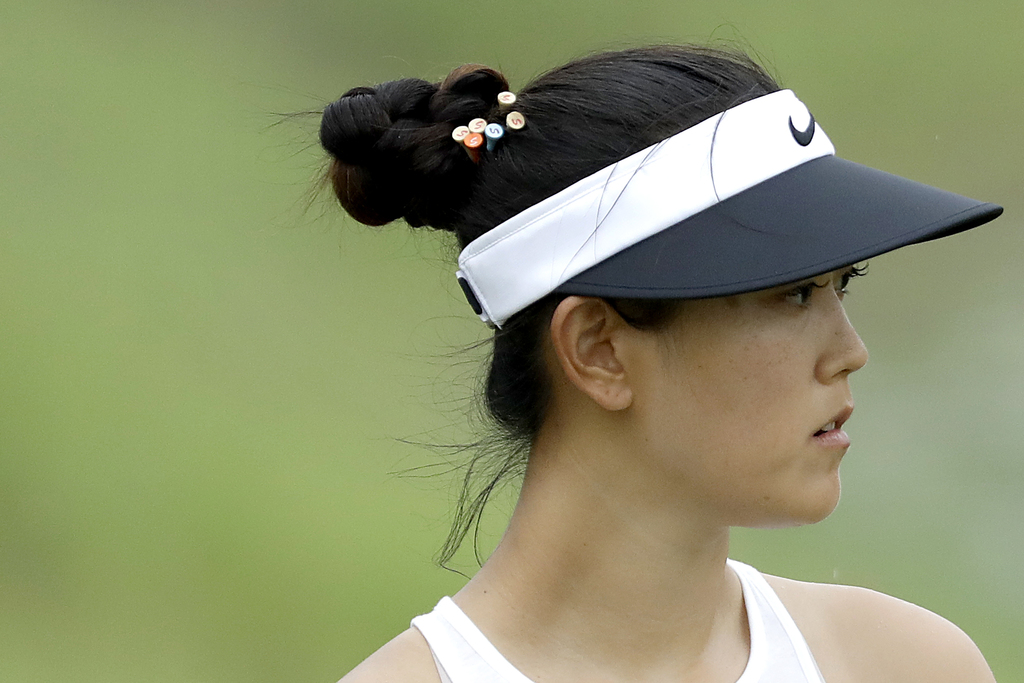 Michelle Wie of the United States looks at her ball on the 8th hole during the HSBC Women's Champions golf tournament held at Sentosa G...