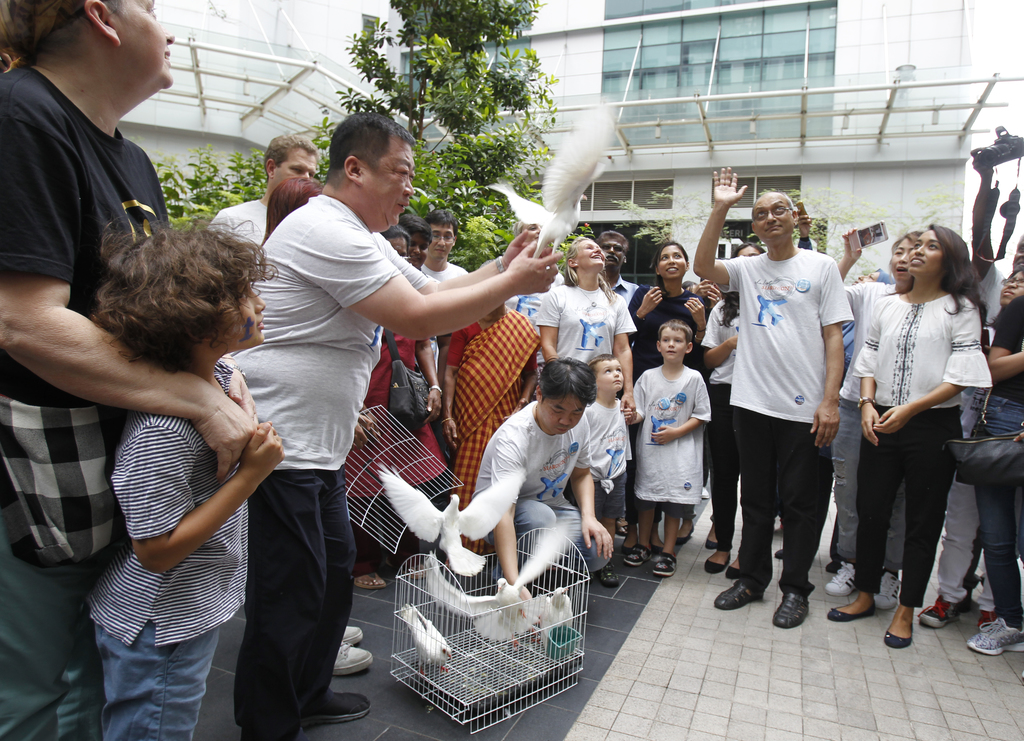 Relatives of the victims of the missing Malaysia MH370 flight release the pigeons during the Day of Remembrance event in Kuala Lumpur, ...