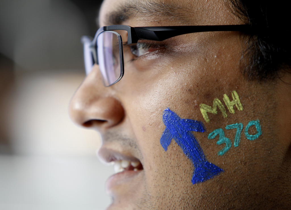 In this Saturday, March 4, 2017, photo, a man with a painted face attend the Day of Remembrance for MH370 event in Kuala Lumpur, Malays...