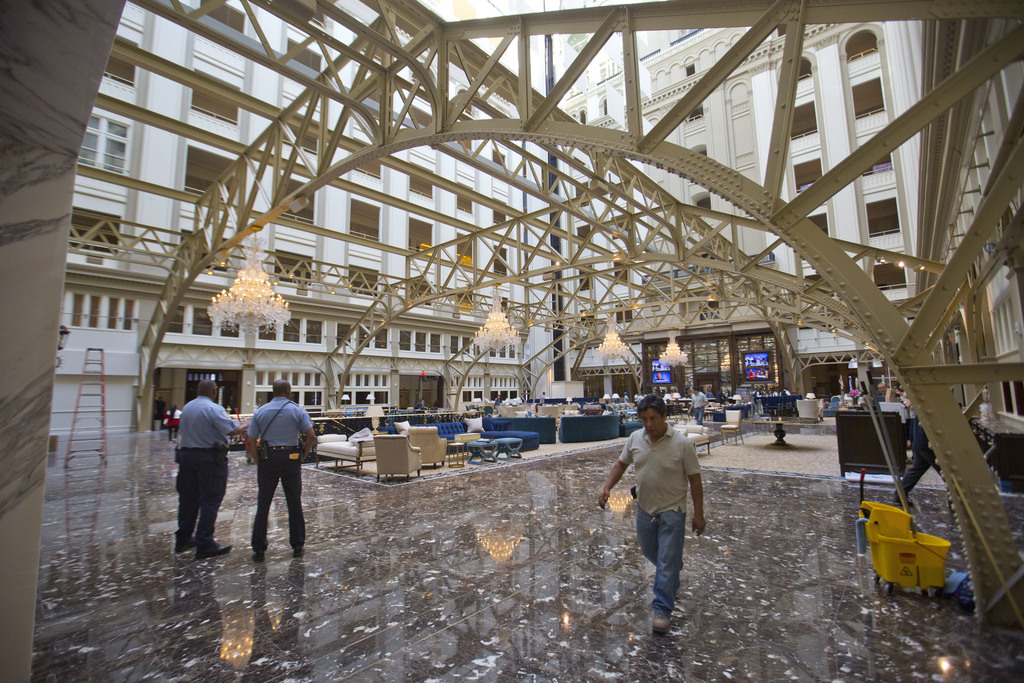 FILE - In this Sept. 12, 2016 file photo, the main lobby of the Trump International Hotel in downtown Washington. Trump's $200 million ...