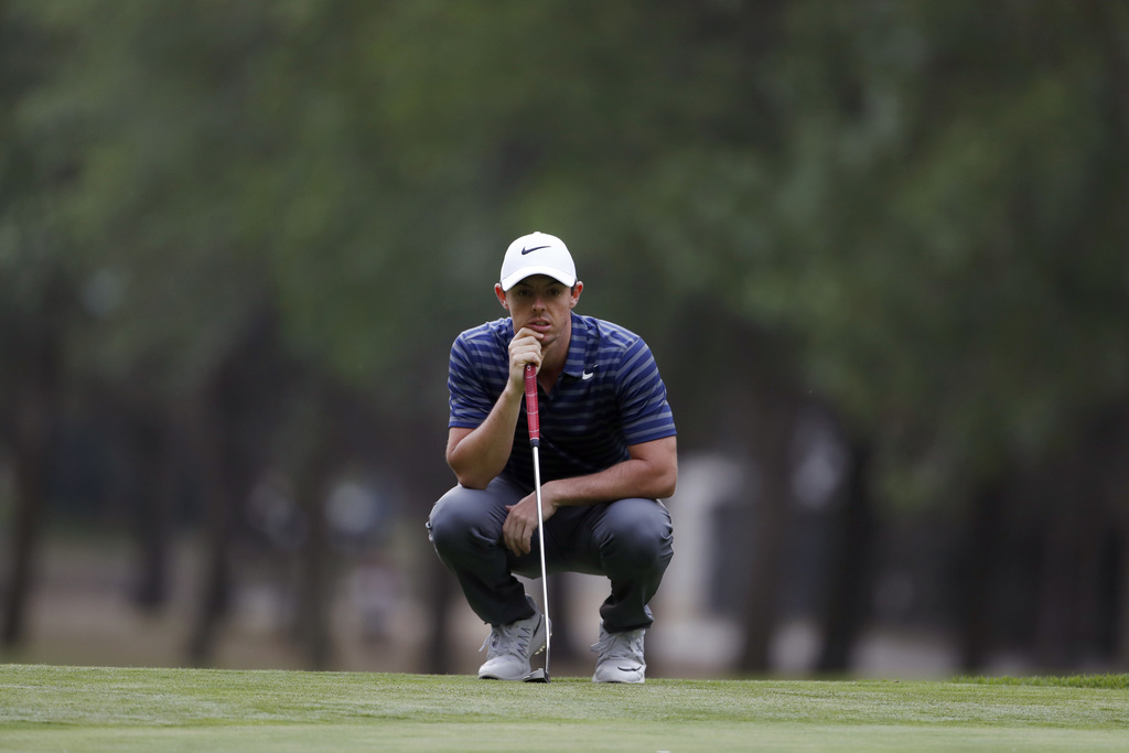 Rory McIlroy, of Northern Ireland, prepares to putt on the 17th hole green in round two of the Mexico Championship at Chapultepec Golf ...