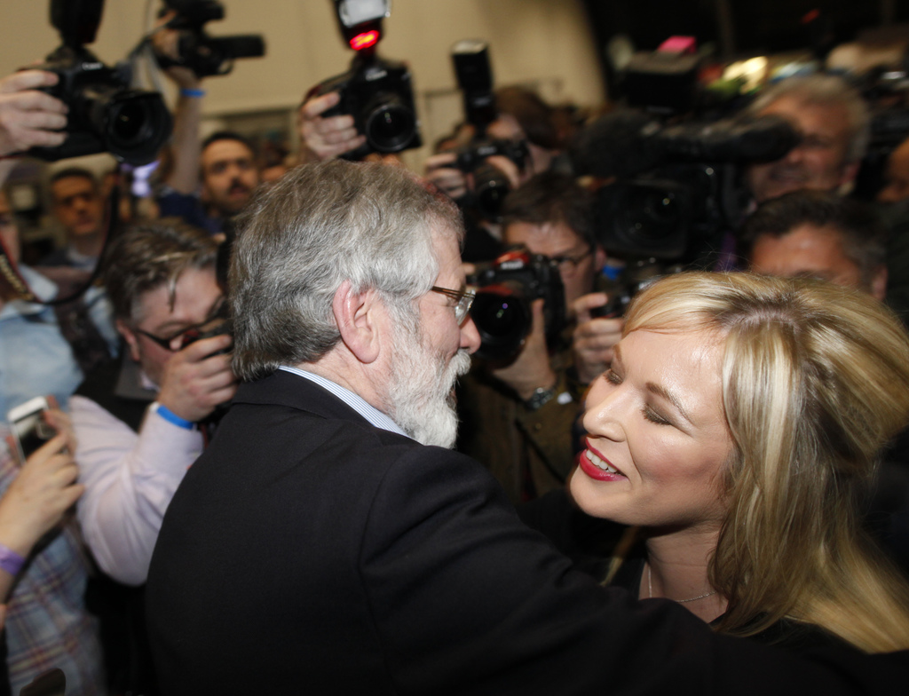 Sinn Fein's Michelle O'Neill is congratulated by party leader Gerry Adams at the count centre in Belfast, Northern Ireland, Friday, Mar...