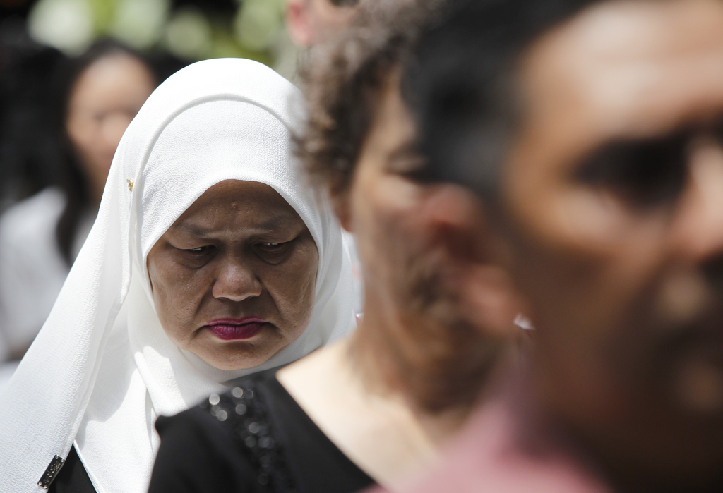 Relatives of victims of the missing Malaysia MH370 flight have a moment of silence during the Day of Remembrance event in Kuala Lumpur,...