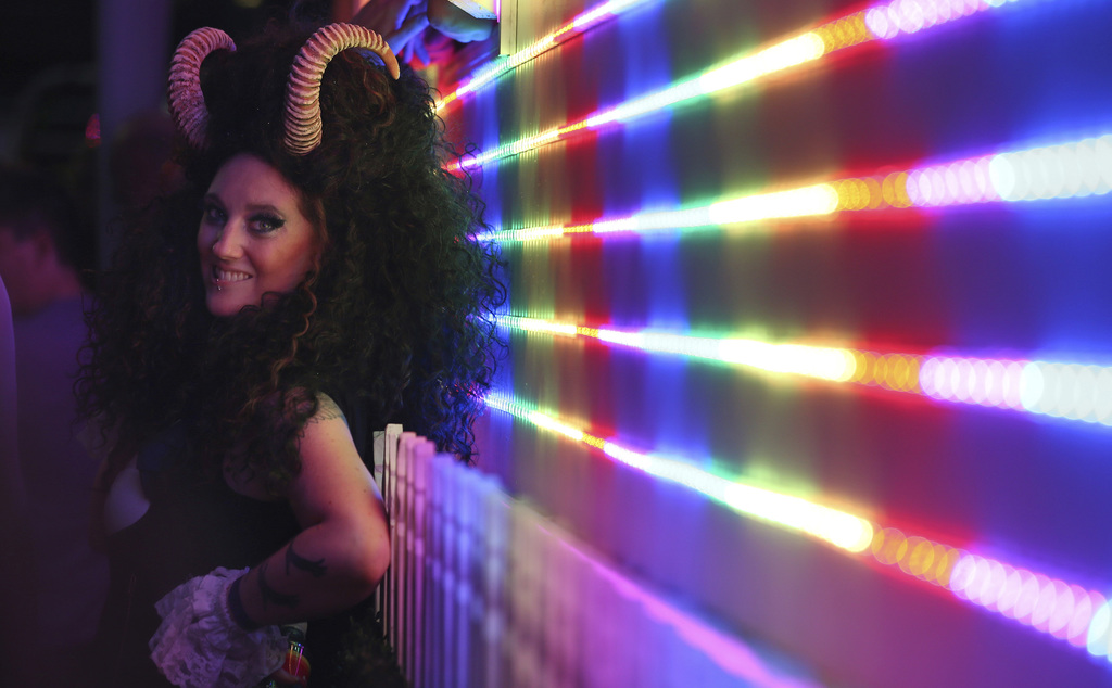 In this Saturday, March 4, 2017, photo, a participant prepares for the annual Gay and Lesbian Mardi Gras parade in Sydney. (AP Photo/Ri...