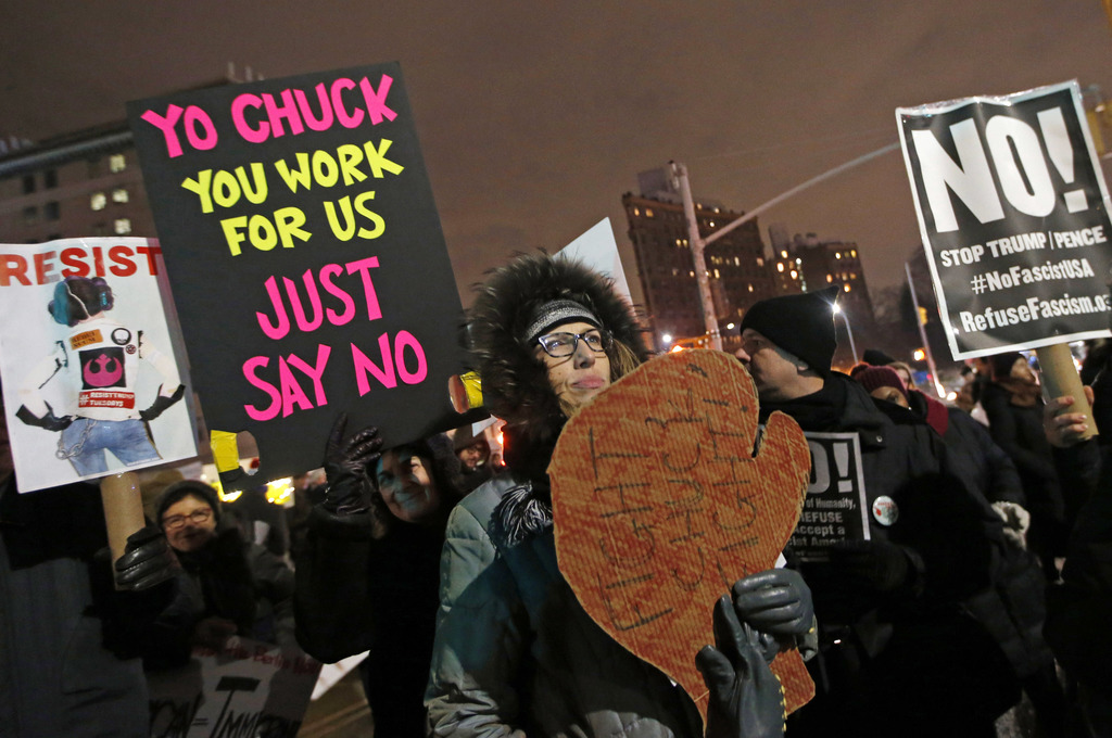 FILE - In this Jan. 31, 2017 file photo, demonstrators call out Senate Minority leader Chuck Schumer of N.Y. during a protest in his Br...