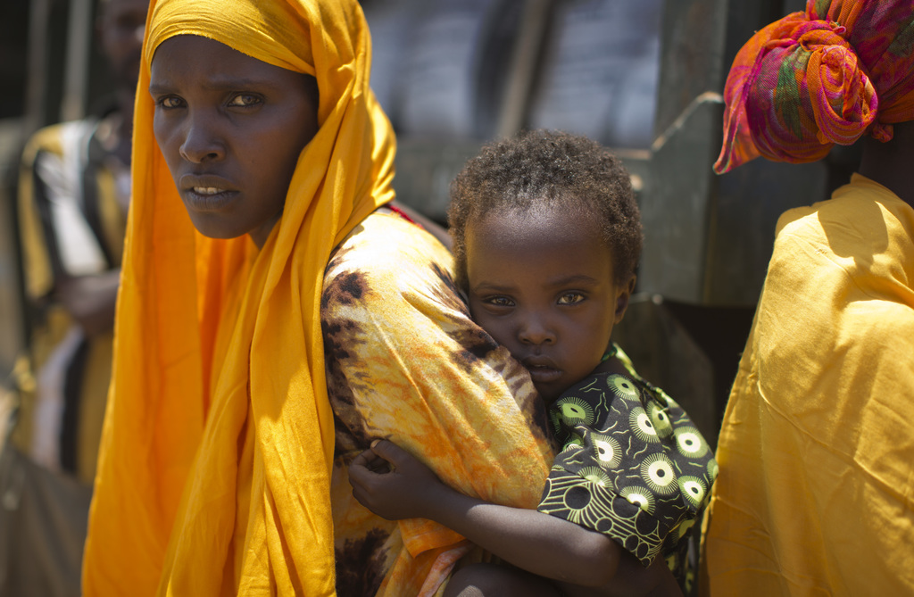 A woman and a child in the drought-affected village of Bandarero, near Moyale town on the Ethiopian border, in northern Kenya, Friday, ...