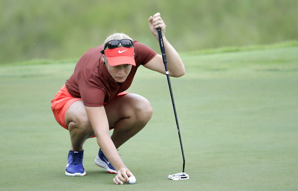 Suzann Pettersen of Norway places her ball on the putting green of the 8th hole during the HSBC Women's Champions golf tournament held ...