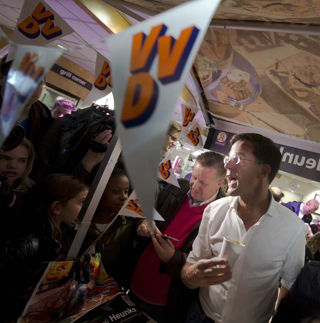 Dutch Prime Minister and VVD party leader Mark Rutte, right, answers questions during an election campaign stop in Barendrecht, near Ro...
