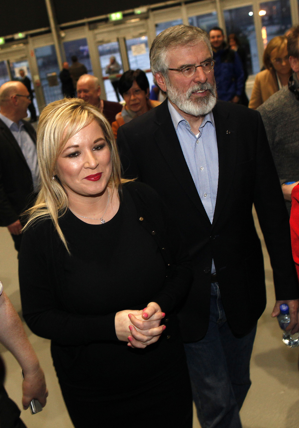 Sinn Fein's Michelle O'Neill and party leader Gerry Adams arrive at the count centre in Belfast, Northern Ireland, Friday, March 3, 201...