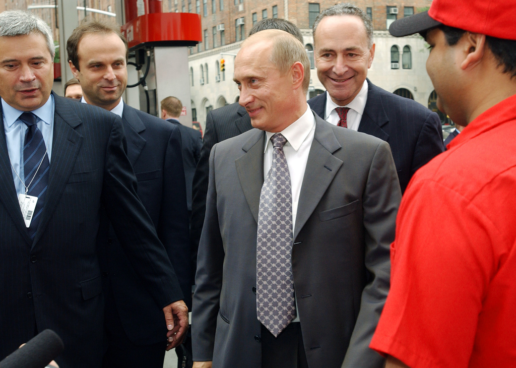 FILE - In this Sept. 26, 2003, file photo, Russian President Vladimir Putin, center, and Sen. Charles Schumer D-N.Y., second from right...