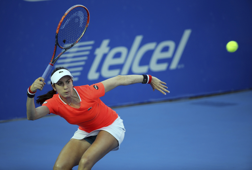 Christina Mchale, from the U.S., returns to France's Kristina Mladenovic during a semifinal match of the Mexican Tennis Open in Acapulc...