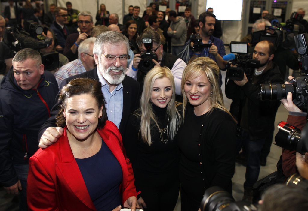 Sinn Fein's Michelle O'Neill , right, is congratulated by party leader Gerry Adams and party members Orlaithi Flynn, 2nd right, and Mar...