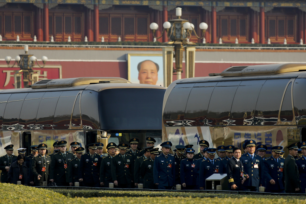 Delegates from China's People's Liberation Army (PLA) line-up as they arrive at the Great Hall of the People to attend a plenary sessio...