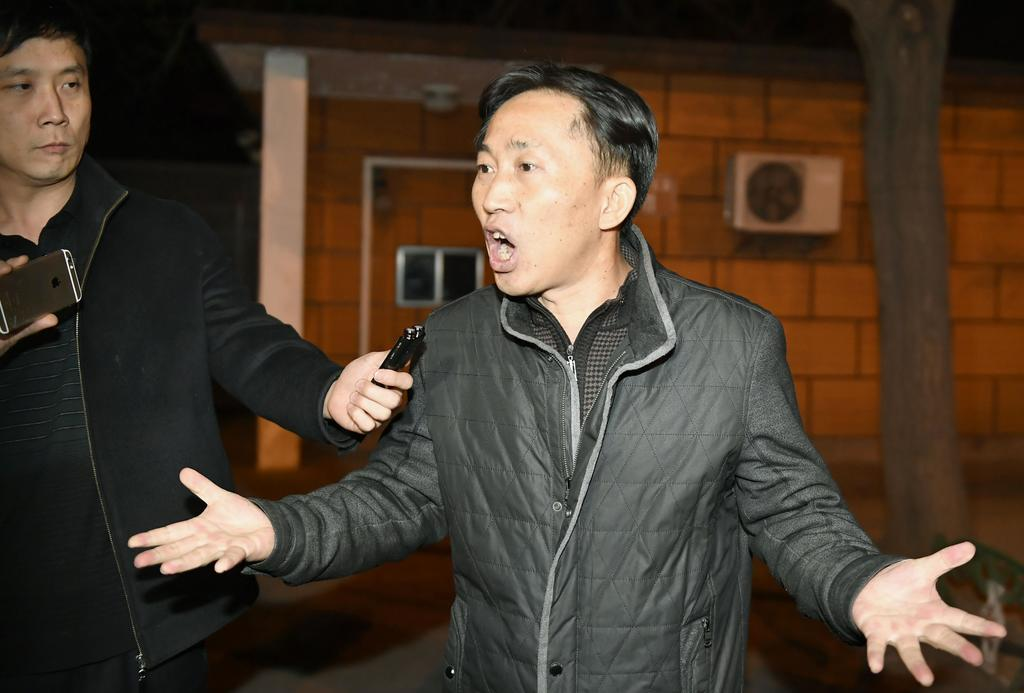 North Korean Ri Jong Chol speaks in front of reporters at the North Korean Embassy in Beijing early Saturday, March 4, 2017. Malaysian ...